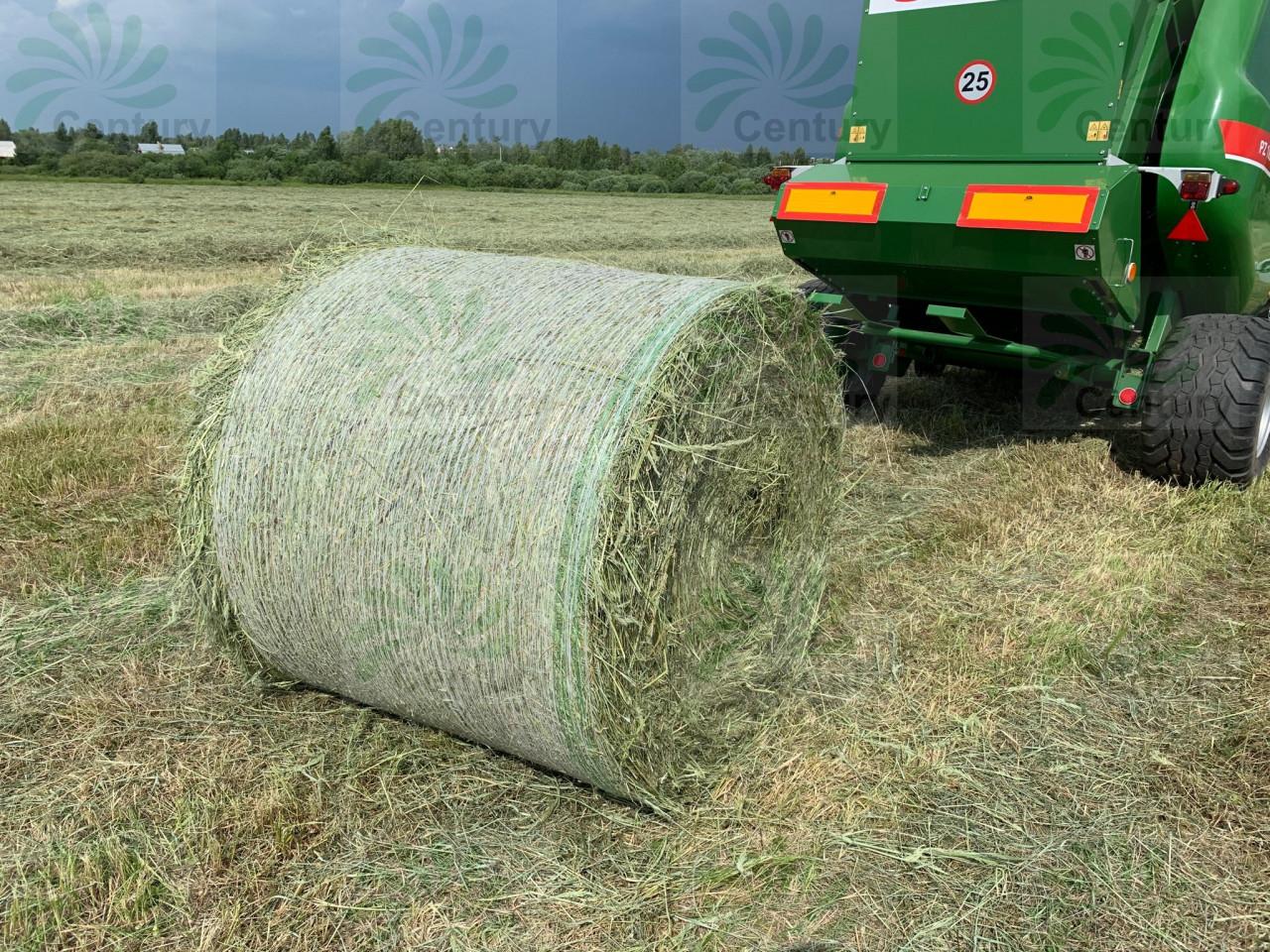 Обмотка рулона сена сеновязальной сеткой Тянь-Жень