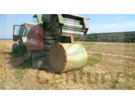 Обмотка рулонов сена сеновязальной сеткой Тянь-Жень